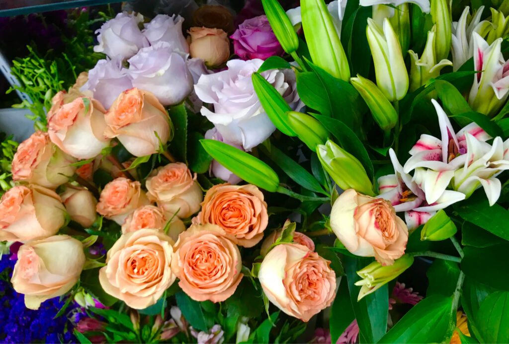 White, peach and pink roses with greens